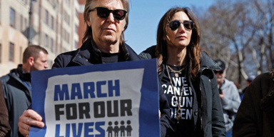 Paul McCartney participates in March For Our Lives in remembrance of his former bandmate, John Lennon