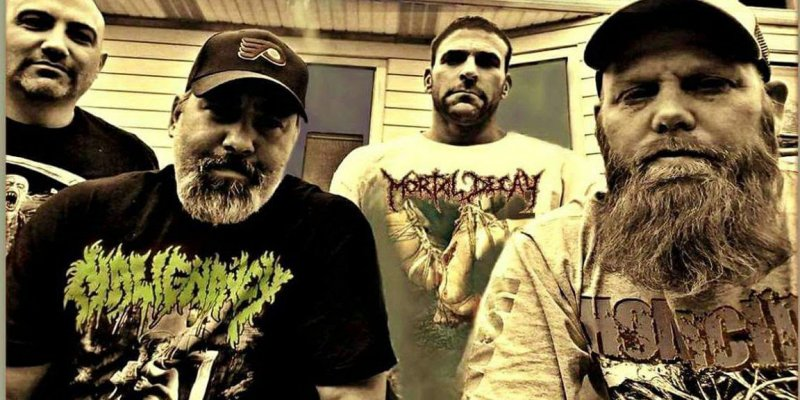 Comatose Music celebrate 20 years of Mortal Decay's classic A Gathering Of Human Artifacts with an anniversary reissue with new, brutal artwork.