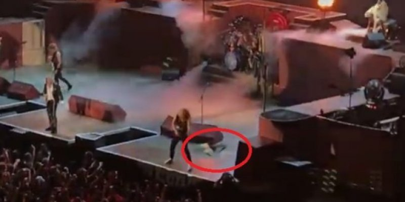 Watch IRON MAIDEN's Janick Hit A Security Guard With His Guitar