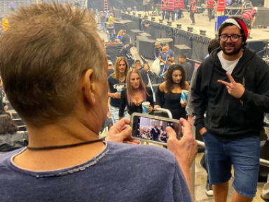 Some guy asks EDDIE VAN HALEN to take a picture of him with the stage behind him at the TOOL show, having no idea who EDDIE is!