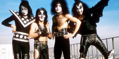 KISS WORKING ON BOOK OF POSTERS